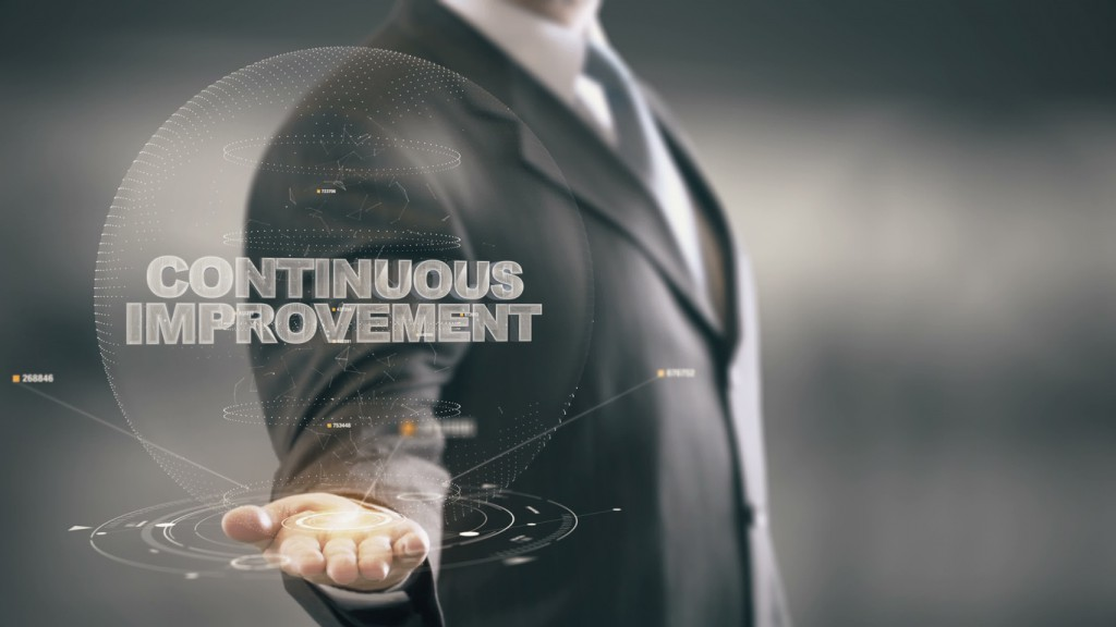 Continuous Improvement with hologram businessman concept