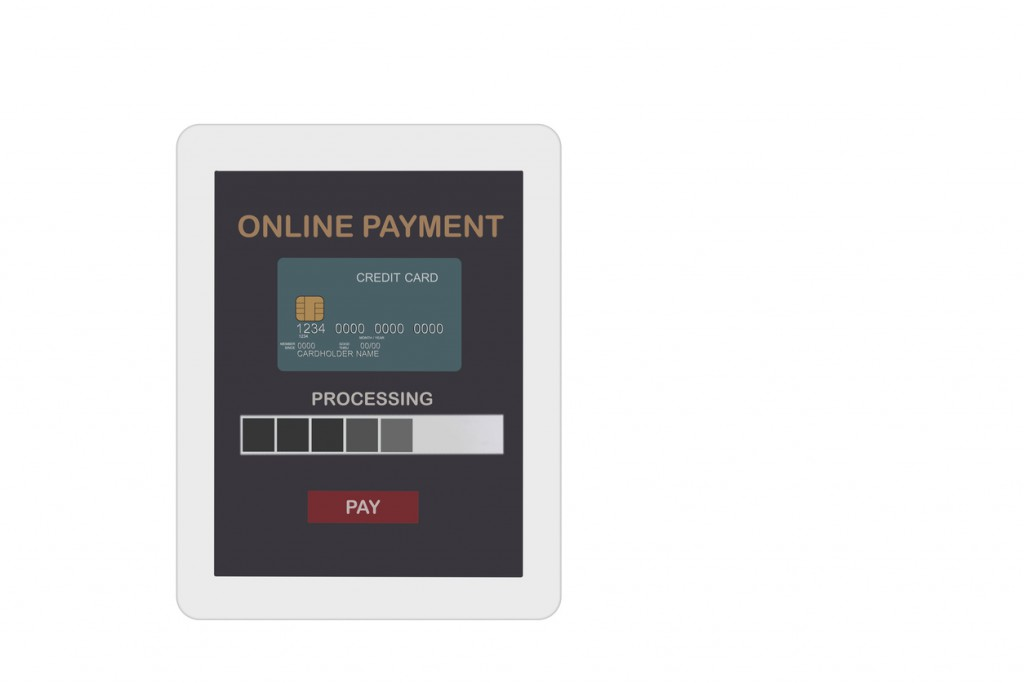 Online payment application with credit card on computer tablet on white background