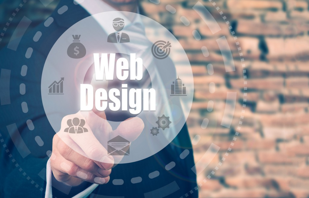 Businessman selecting a Web Design Concept button