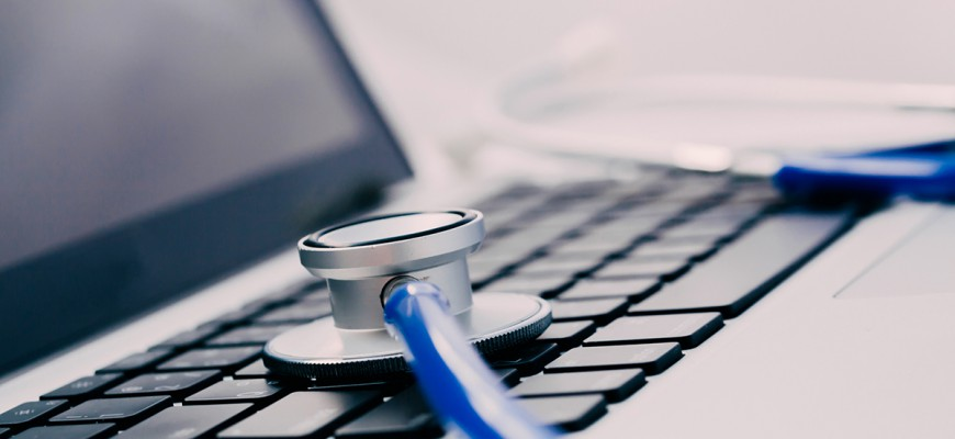 Stethoscope on laptop - Computer protection and repairing maintenance concept