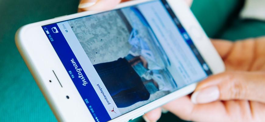 Woman using Instagram app on Apple's iPhone 6