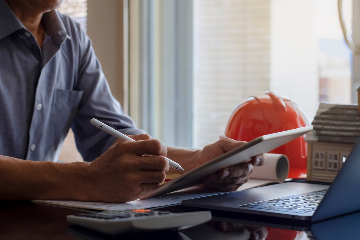 Man works on contractor SEO for his business